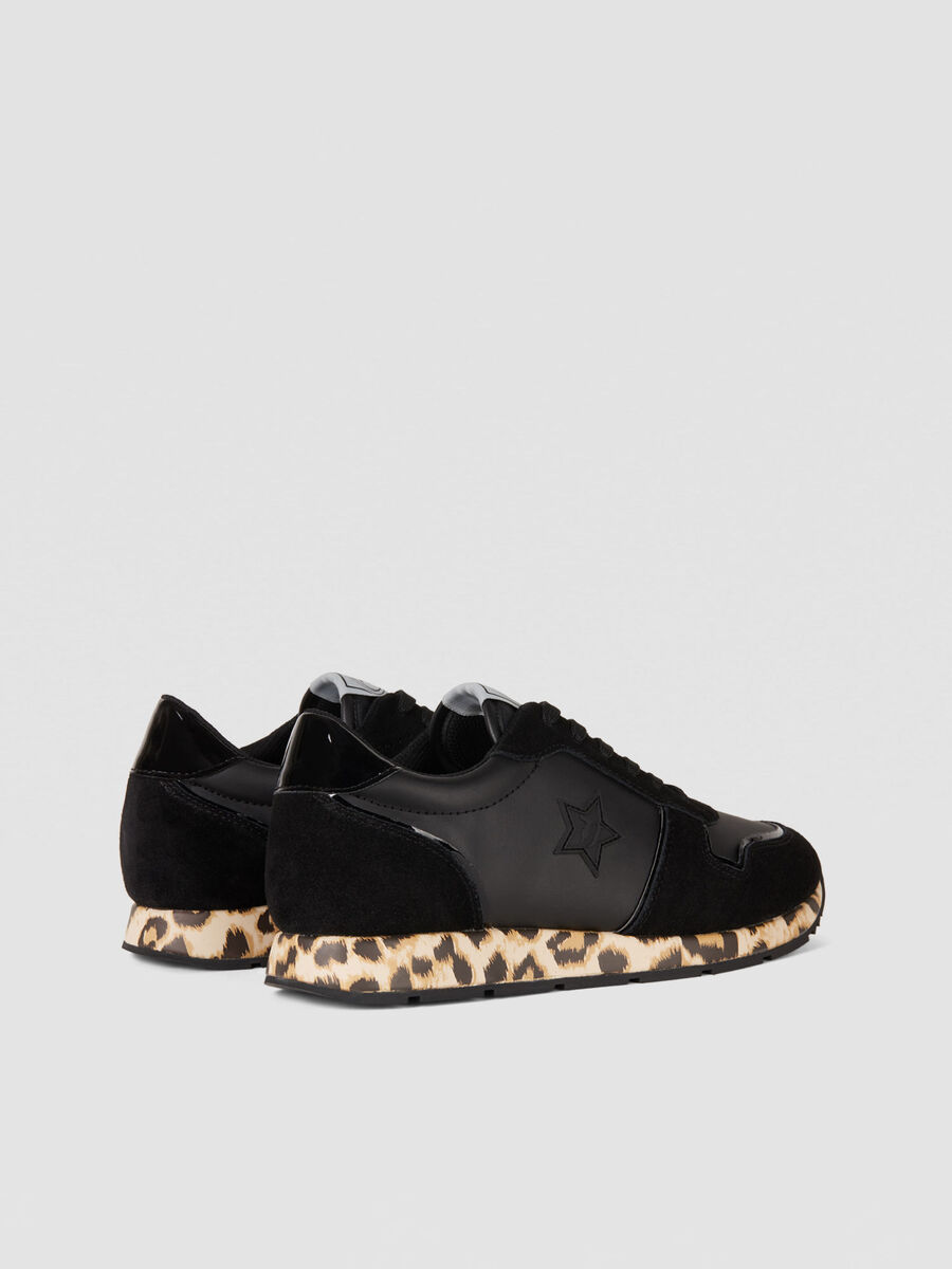 Running sneakers in animal print monogram faux leather