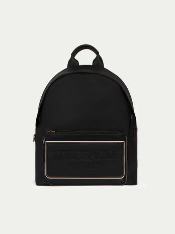 Medium leather backpack with pocket piping