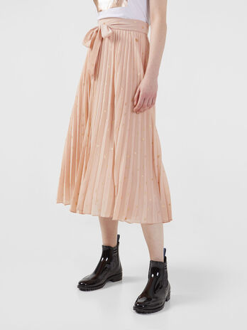 Pleated flowing fabric skirt with all over print
