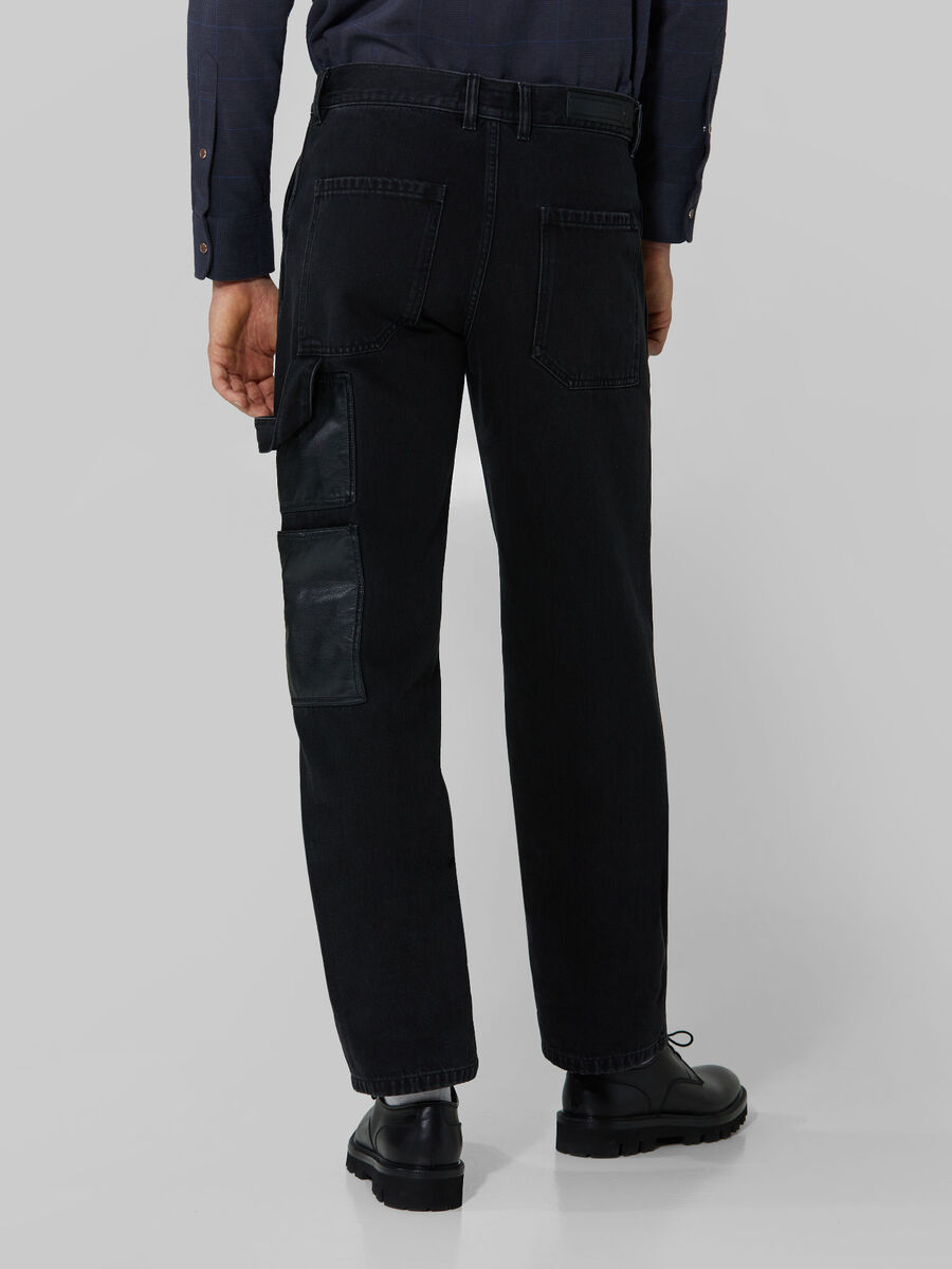 Work fit denim and faux leather jeans