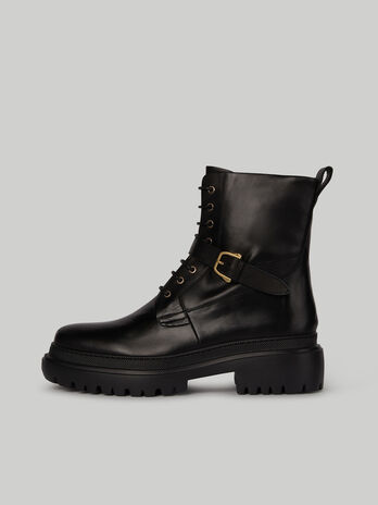Leather combat boots with strap