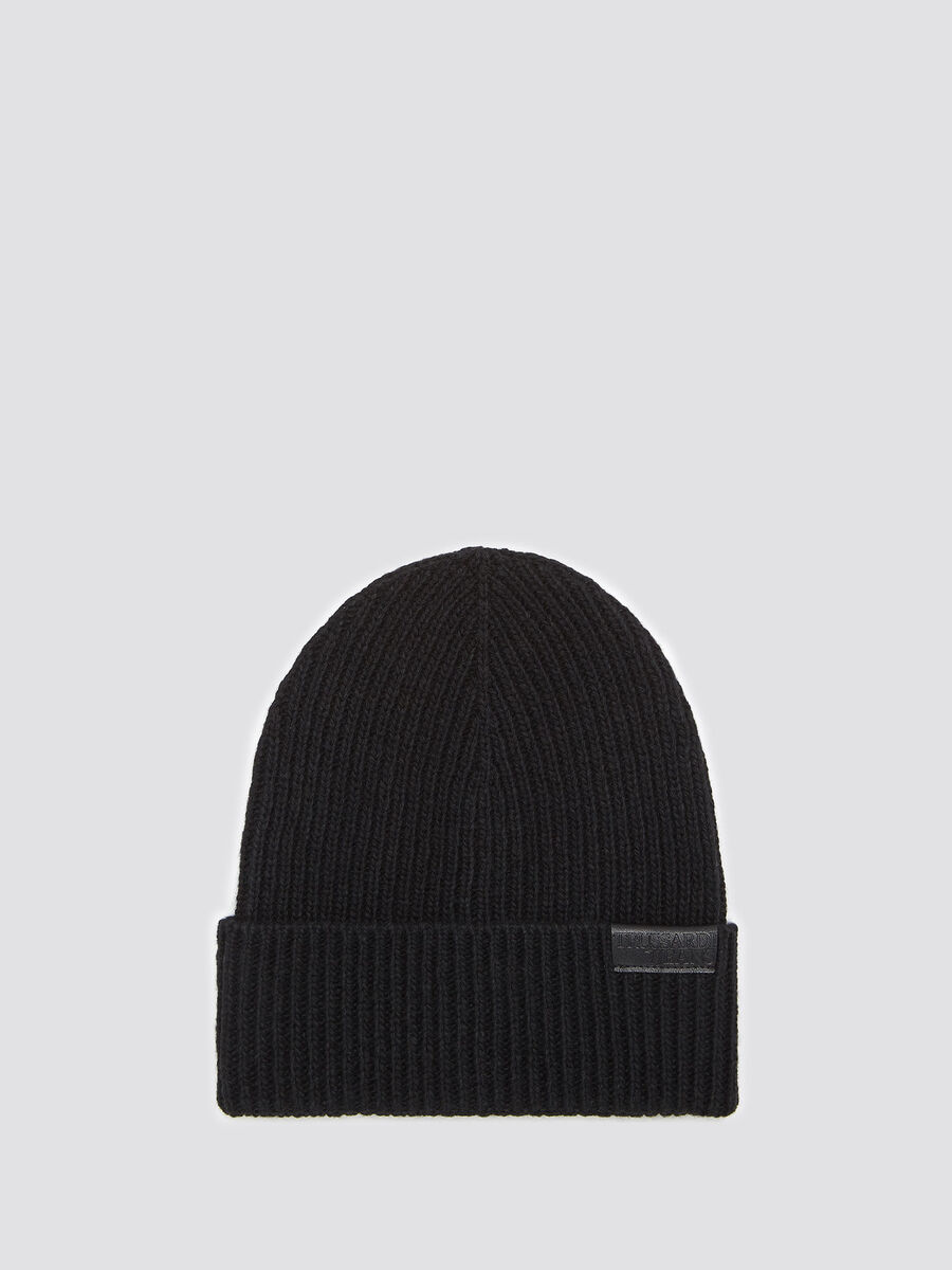 Hat with leather insert