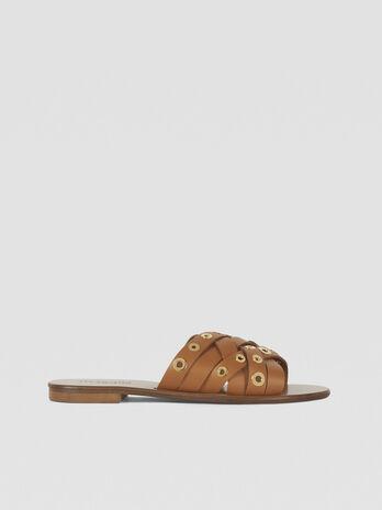 Sandalia plana de piel trenzada