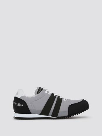 Sneakers de running avec bandes et logo