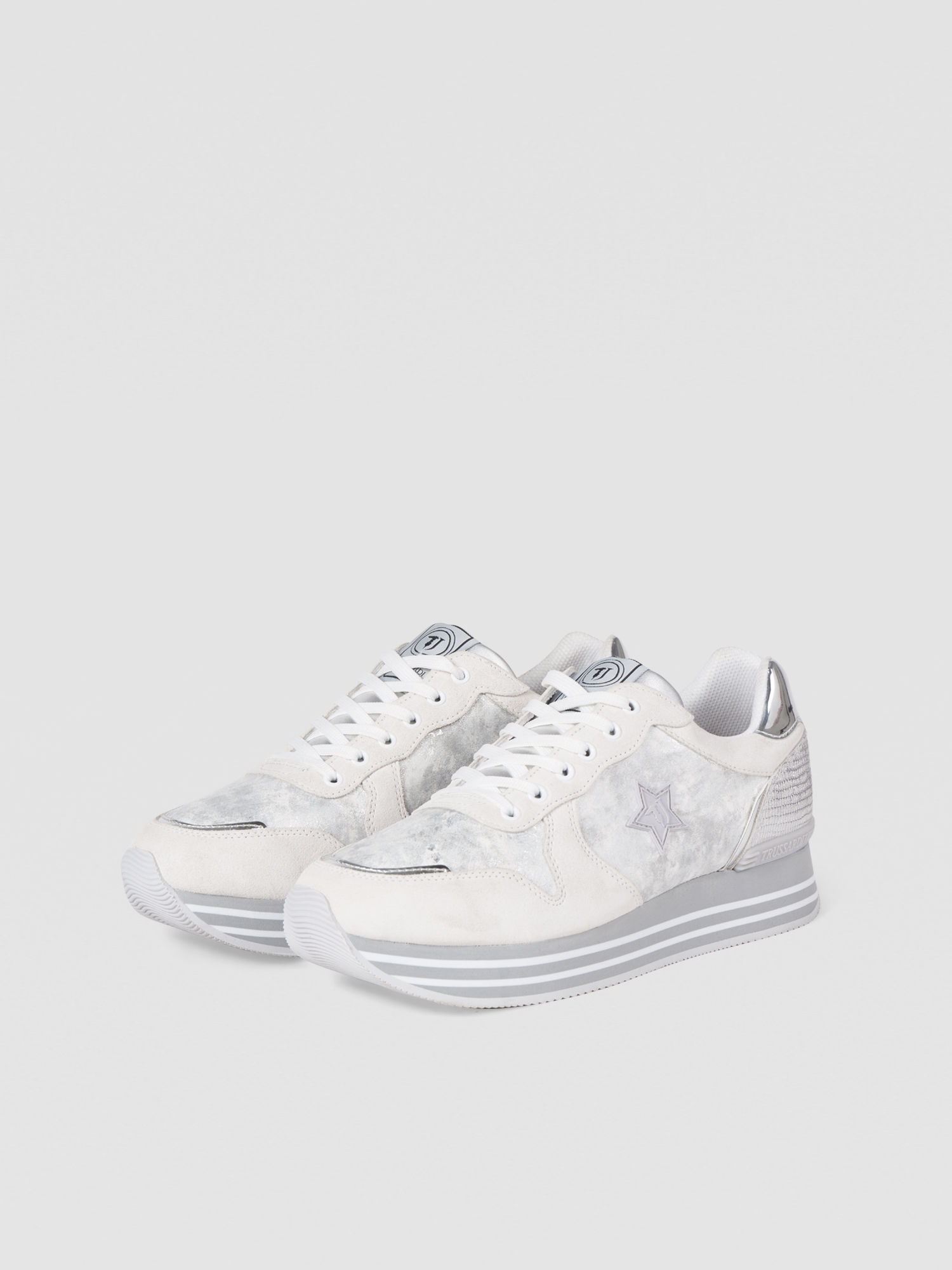 Faux leather sneakers with platform and
