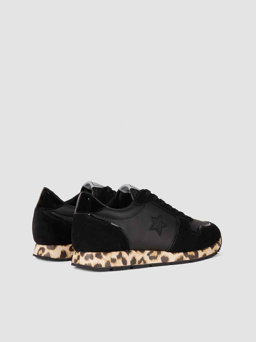 Running sneakers in animal print monogram faux leather